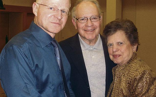 At Highland Park Conservative Temple, Noam Shalit, left, greets Dorothy and Edward Thompson of Monroe.