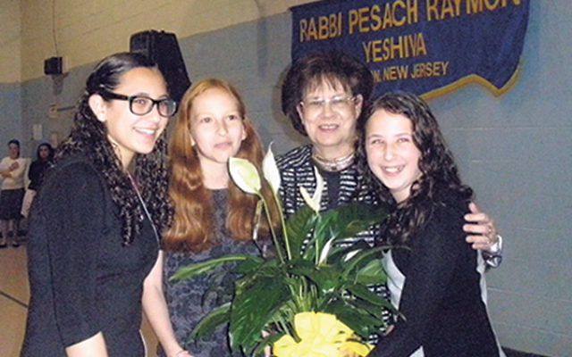 Names, Not Numbers creator Tova Fish-Rosenberg is thanked for her work at RPRY by students from left Gila Allen, Rachel Goldman and Shayna Dessau.