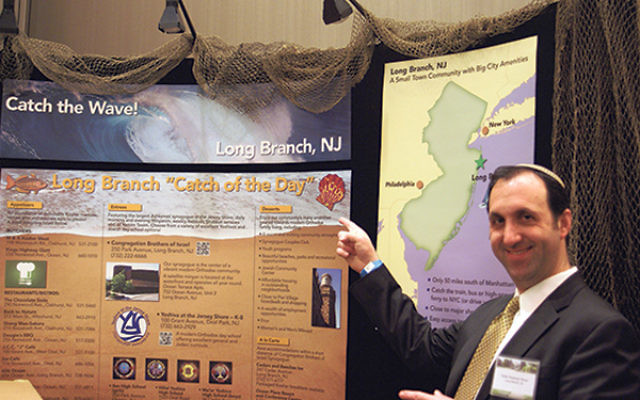 Rabbi Nasanayl Braun, of Congregation Brothers of Israel at the Long Branch/Brothers of Israel booth at a previous OU Communities Fair.