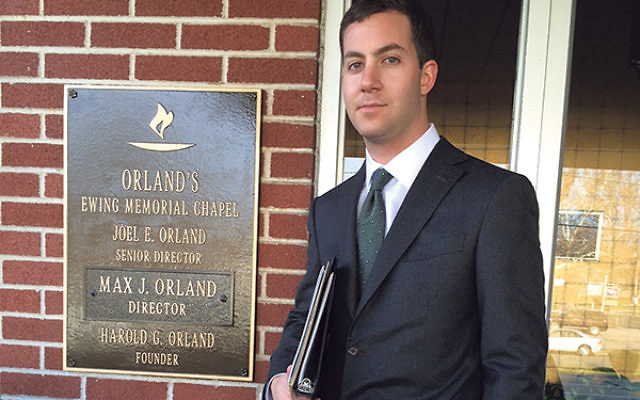 """Max Orland, in front of Orland's Ewing Memorial Chapel; he's well-suited to his job, he said; """"I like working with people."""""""