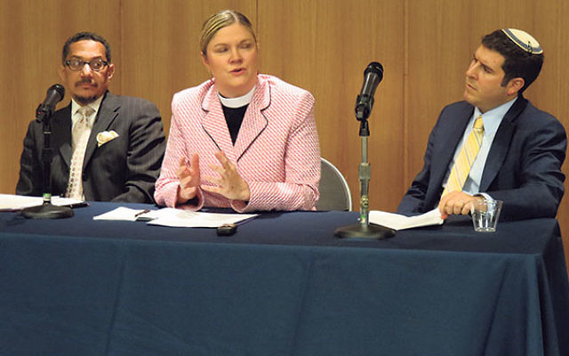 Panelists, from left, Imam W. Deen Shareef, Pastor Christa Compton, and Rabbi Jesse Olitzky, consider the religious implications of achieving peace.