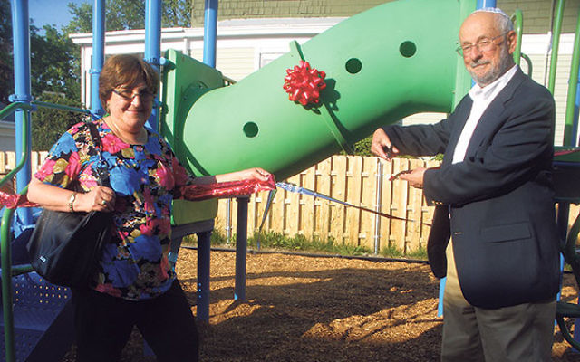 Bart Weinstein and his wife, Debra Goldstein, cut the ribbon for the new playground named in memory of his son, Seth.