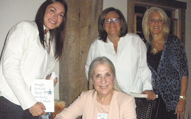 Letty Cottin Pogrebin, seated, is joined by, from left, Women's Philanthropy cochair Louisa Liechtung and national Women's Philanthropy and Heart of NJ federation board members Sheryl Grutman and Linda Block.