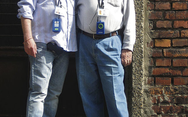 At Auschwitz-Birkenau, Leslie Listwa and his father, Siegmund, outside Block One, where the elder man was interned.