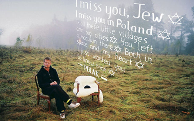 "In his ""I miss you Jew"" campaign, Polish artist Rafal Betlejewski asks Poles to photograph themselves with an empty chair signifying the void left in the country by the loss of its Jews."