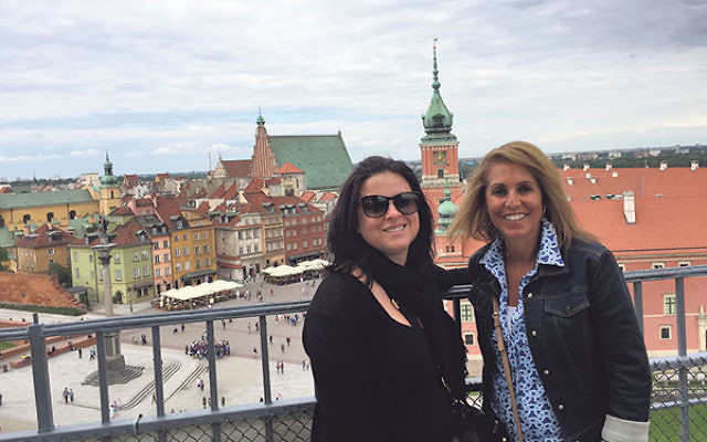 Educators Melissa Weiner, left, and Judy Rosen in a spot overlooking Old Town in Warsaw.