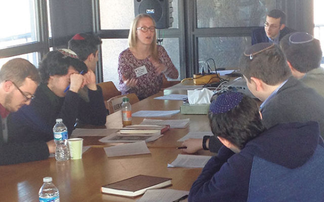 Undergraduate Judaic Studies Conference presenter Emily Goldberg, center, fields questions about her research on the Rebbe's Ohel.