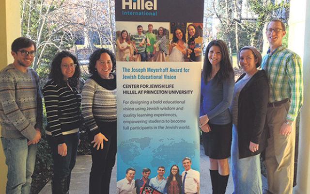 Joining Princeton CJL executive director Rabbi Julie Roth, third from left, in celebrating its national award for Jewish educational vision are education team members, from left, Slav Leibin, Rabbi Sara Rich, Marni Blitz, Ilana Bercuson, and Rabbi Eliezer