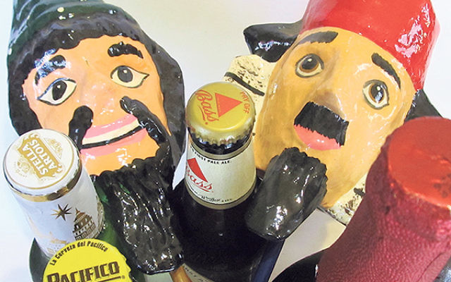 Groggers and beer, two important elements of a Purim celebration