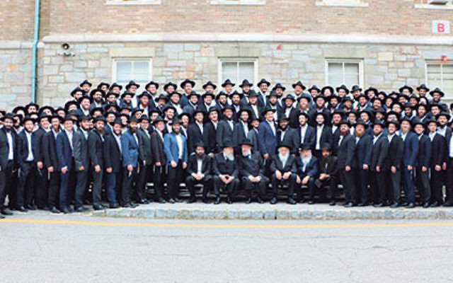 The new RCA graduates with their professors and Rabbi Israel Lau.