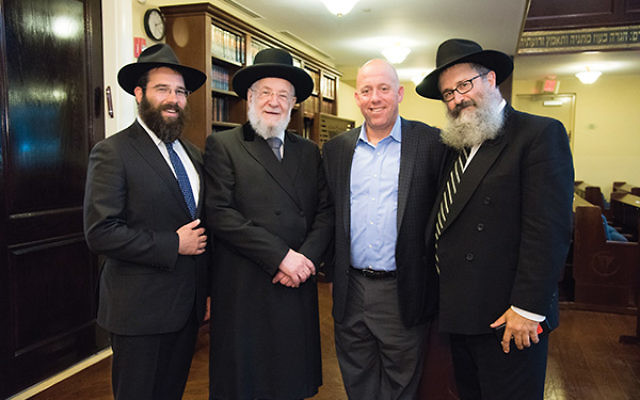 Former chief Ashkenazi rabbi of Israel, Yisrael Meir Lau, second from left, is flanked by executive director of Chabad of the Shore Rabbi Laibel Schapiro, at left, Jewish Federation CEO Keith Krivitzky, and Rutgers Chabad executive director Rabbi Yosef Ca