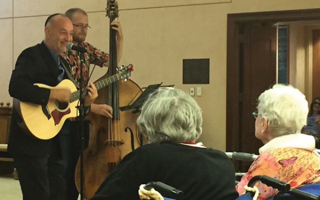 Rabbi Steven Blane and bassist Kevin Hailey mix secular Jewish and mainstream American music as they entertain residents of the Jewish Home at Rockleigh in Bergen County.