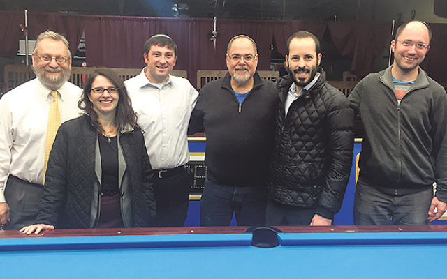 Members of the Rabbinical Association in the Heart of NJ at their first social event, held Dec. 21 at Sandcastle Billiards in Edison are, from left, Rabbis Robert Wolkoff (Congregation B'nai Tikvah, North Brunswick), Esther Reed (Rutgers Hillel), Ja