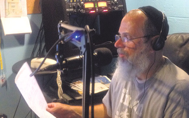 Al Gordon broadcasts Jewish programming from the Edison studios of WJPR, which he owns and operates.