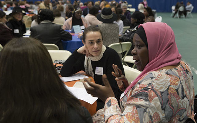 Muslim and Jewish women converse at the Dec. 4 Sisterhood of Salaam Shalom conference at Drew University.
