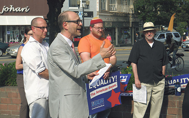 Rabbi Elliott Tepperman of Bnai Keshet, who organized the rally in Montclair celebrating the Supreme Court's decision legalizing same-sex marriage in all 50 states, was joined by other Jewish leaders, including Rabbi Steven Kushner, far right.
