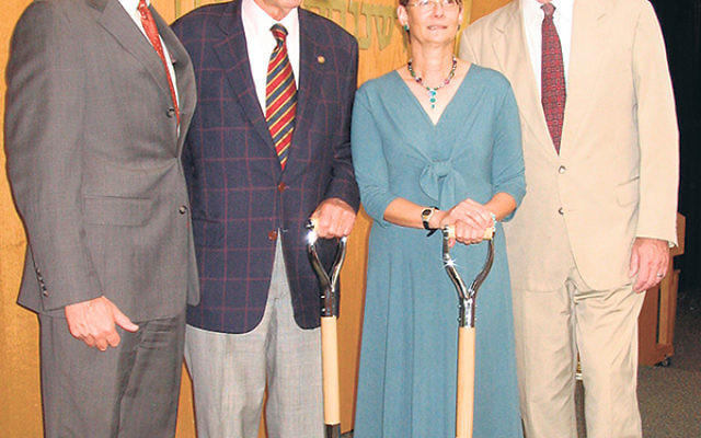 Joyce Raynor wields a shovel at a symbolic ground breaking June 19, 2007, for the $4.5 million renovation of Solomon Schechter Day School of Essex and Union; with her are, from left, SSDS board president Mark Lederman, school benefactor Eric F. Ross, and