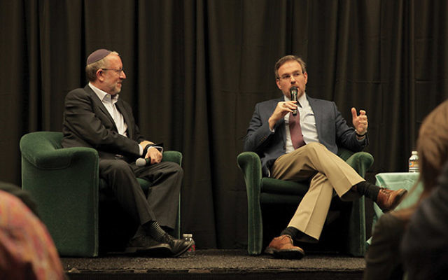 The New York Times's Bret Stephens, at right, addresses the large audience at the Aidekman Family Jewish Community Campus in Whippany. The second panelist, Yossi Klein Halevi, author of several books, is on the left. Photo by David Thomas