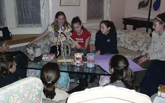 Girls at Rabbi Paula Mack Drill's Rosh Hodesh: It's A Girl Thing group in November 2003. Vered Idan is on the sofa at left.
