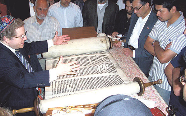 In 2009, at a Shabbat of Sharing held with a Boonton mosque, Rabbi Donald Rossoff showed Muslim guests a Torah scroll rescued after the Holocaust and explained its significance.