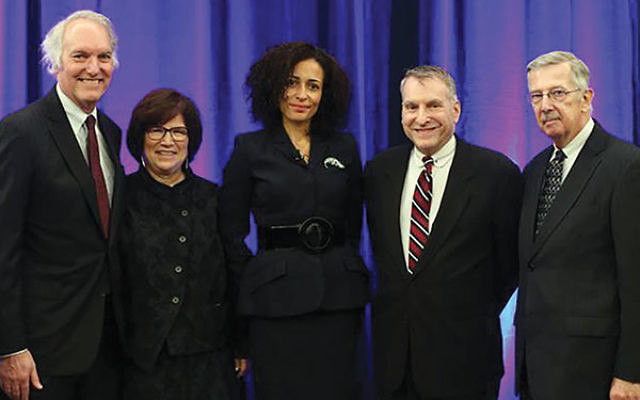 English novelist Zadie Smith, center, who delivered the inaugural lecture for the Philip Roth Lecture Series at the Newark Public Library, Oct. 27, is joined by, from left, Timothy Crist, Rosemary Steinbaum, Benjamin Taylor, and Thomas Alrutz.