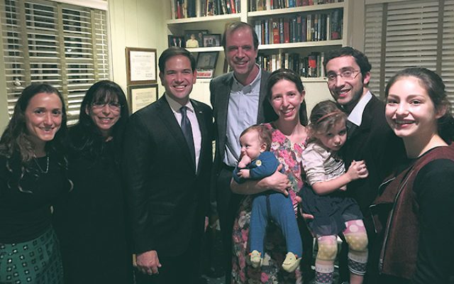 Republican presidential candidate Marco Rubio, third from left, with Howard Jonas, center, and his family at the NORPAC fund-raiser.