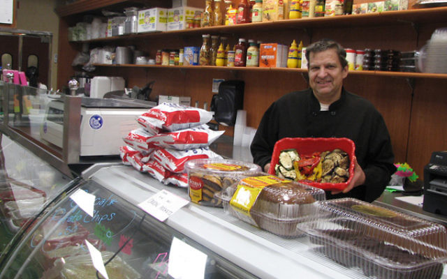 "Hal Robinson, chef and owner of the Rye Deli, calls food preparation ""an art"" and ""my passion."""