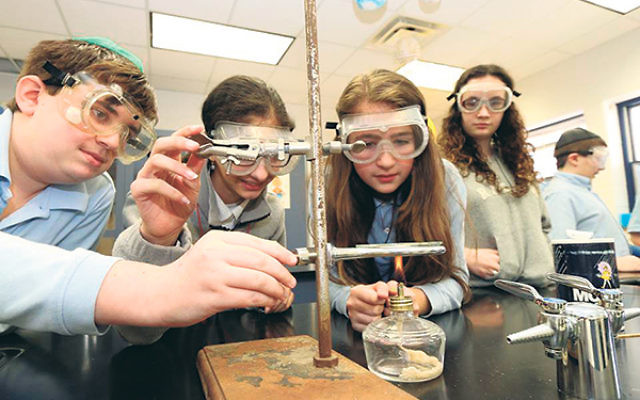 "Students in a science lab at the Shalom Torah Academy in Morganville. The administration is promising a ""state-of-the-art"" education when it reopens in September after a merger of its Morganville and East Windsor campuses."