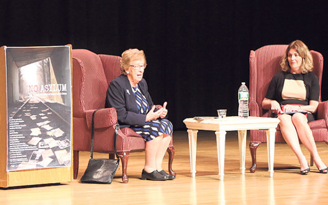 Eva Schloss addresses the audience; Jane Goldstein, academic supervisor at Freehold Regional High School District, served as moderator.