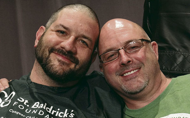Rabbis Joel Abraham, left, and David Levy show off their bald pates.