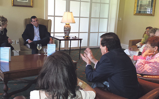 Following his talk at Green Brook Country Club, Israeli journalist Ari Shavit, accompanied by book club leader Marlene Cohen, answered questions from buyers of his book, My Promised Land.