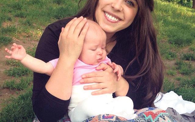 Myriam Schottenstein, founder of the sheitel review website ShayTell, and her baby.