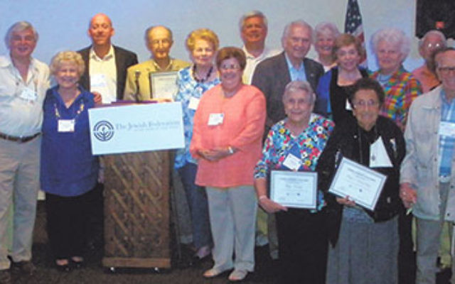 With the residents of active-adult communities who were honored for giving to federation for at least 20 years is Keith Krivitzky, rear, sixth from left, CEO of the Jewish Federation in the Heart of NJ.