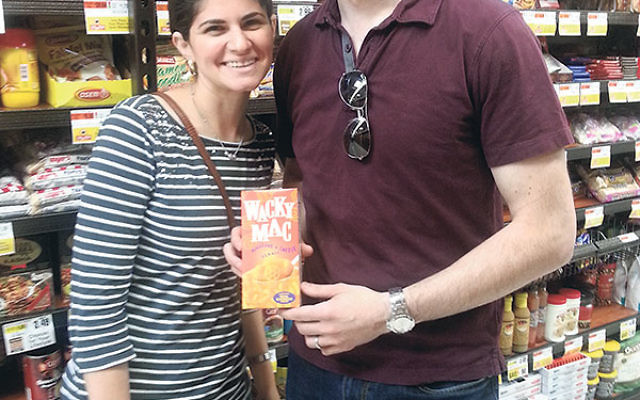 Daniella and Ben Hoffer — who have spearheaded an effort on behalf of the Orthodox community in Springfield to bring a wider array of kosher goods to the new ShopRite on Route 22 in Union — in the grocery aisle with one of the staples in their