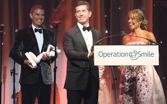 Barbara Majeski receives the Founders Circle Award with her husband, James, left, and Johnson & Johnson CEO Alex Gorsky at the Operation Smile banquet in May.