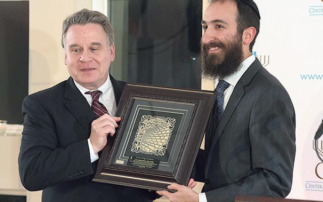 U.S. Rep. Chris Smith, left, receives his award from CJL's Rabbi Yossi Kanelsky.