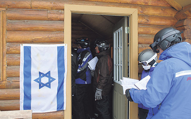 An Israeli flag is posted at Deer Valley's Sunset Cabin every Friday afternoon to alert skiers to the weekly kabalat Shabbat service.