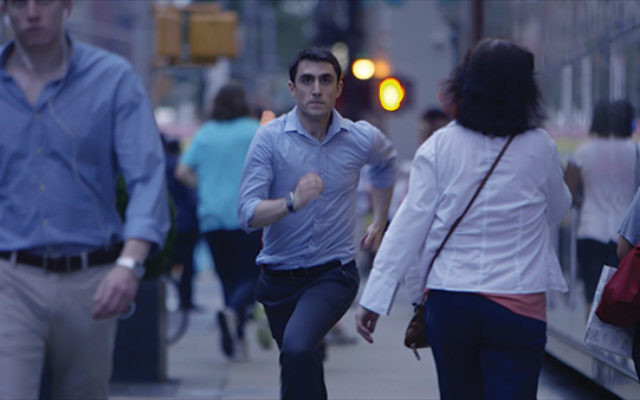 """Actor Danny Hoffman running late to meet a date at a kosher restaurant in a scene from """"Soon by You."""" Photo by Leora Veit"""