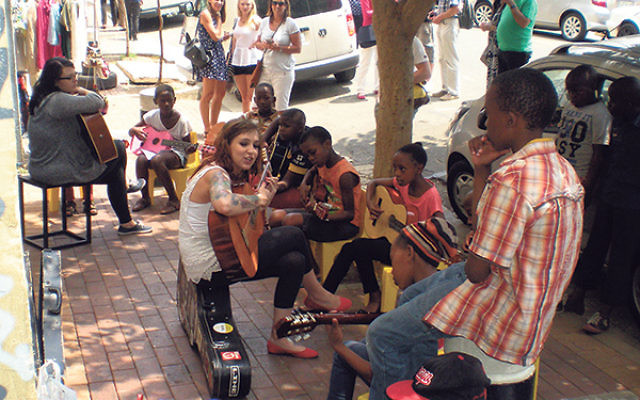 "The bright face of the ""new"" South Africa: Kelly Grevler teaches her weekly, free guitar class in the Maboneng Precinct, Johannesburg."
