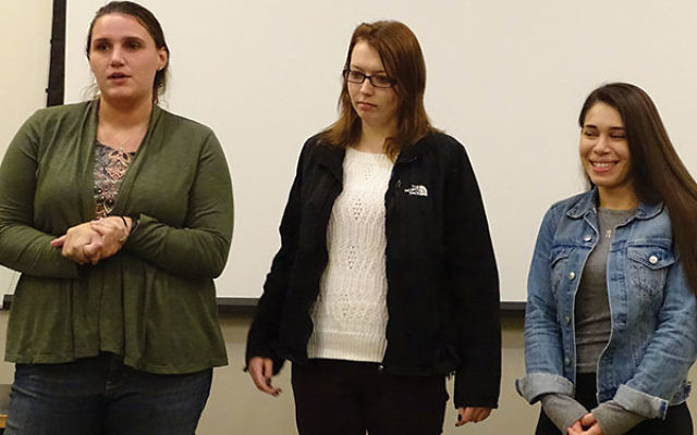College of Saint Elizabeth students, from left, Morgan Sim, Dana Fuardo, and Mia Shevere, describe their visit to concentration camps and Holocaust memorial sites on a trip sponsored by the school's Center for Holocaust and Genocide Education.