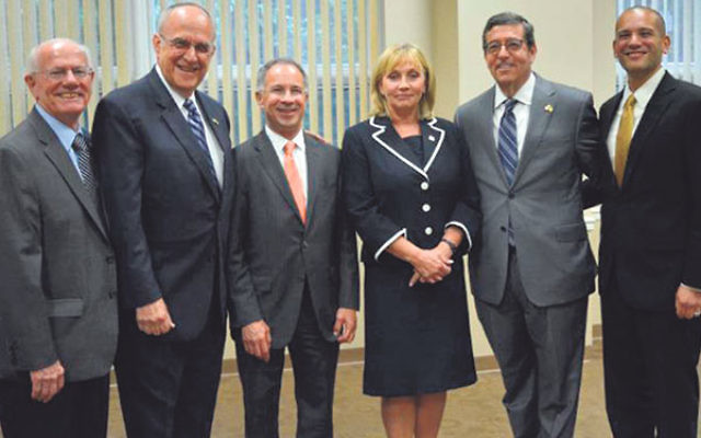 Speakers at the annual meeting of the NJ State Association of Jewish Federations included, from left, executive director Jac Toporek, incoming president Gordon Haas, U.S. Attorney for NJ Paul Fishman, NJ Lt. Gov. Kim Guadagno, past president Mark Levenson
