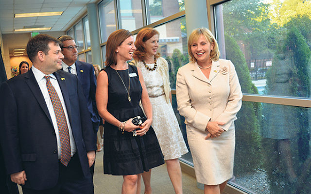 With Lt. Gov. Kim Guadagno, right, on a tour of the JCC of Central NJ are, from left, its president, Ken Rotter; Mark Levenson, president, NJ State Association of Jewish Federations; JCC executive director Jennifer Mamlet; and NJ Assemblywoman Nancy Munoz