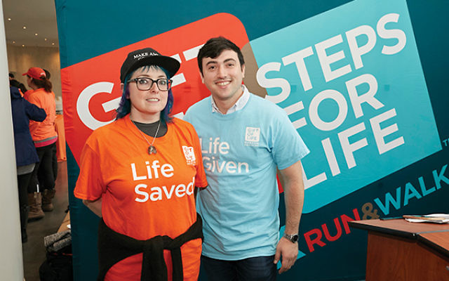 """East Brunswick resident Harvey Pava meets Florence Ivy, the woman whose life he saved through a stem cell donation. Pava said he would donate again """"in a heartbeat."""" Photo courtesy Gift of Life"""