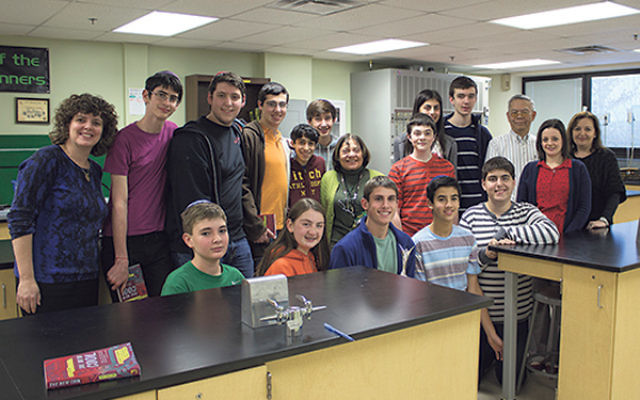 Dr. Lynne B Harrison visits with Golda Och Academy's high school robotics team, the CodeRunners.