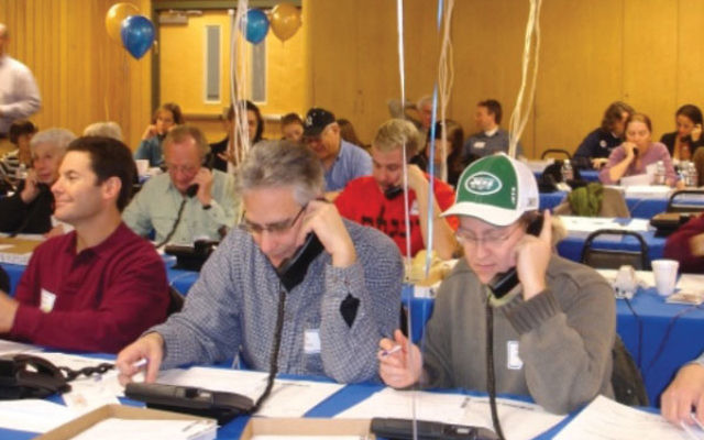 Community members pitch in to make calls at last year's Super Sunday.