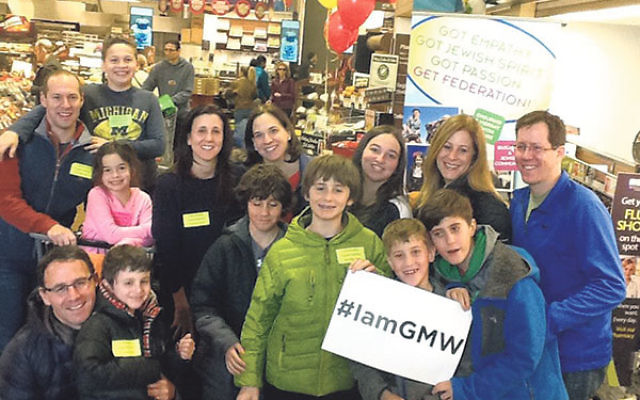 Community members gather items to feed the hungry at last year's Supermarket Sweep.
