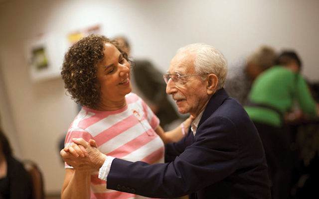 The Flatbush Jewish Center in Brooklyn hosts gatherings for Holocaust survivors and volunteers who provide companionship and support. Stephen Shames/JFNA
