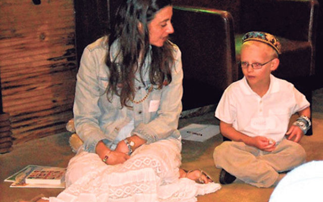"""Beth """"Morah Batya"""" Hancock — with students at the Jewish Congregation of Kinnelon — said the move to one-day-a-week religious school is an example of how Reform Judaism is """"dynamic and able to meet parents where they are.&rdq"""