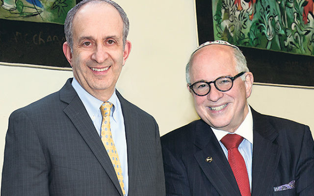 Alan Kadish, left, president and CEO of the Touro College and University System, and Steven Huberman, founding dean of the Touro College Graduate School of Social Work, celebrate the school's national accreditation for another eight years.