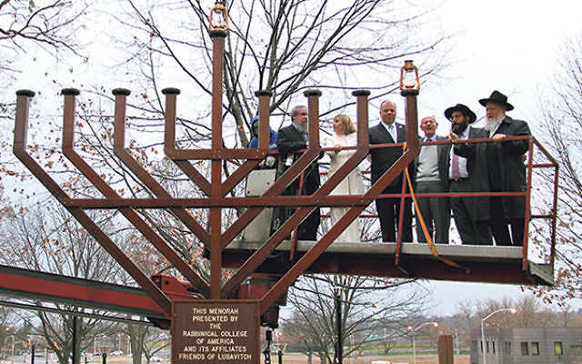 At the lighting of giant menora in front of the State House in Trenton are, from left, Rabbi Boruch Klar, executive director Chabad of West Orange; Lt. Gov. Kim Guadagno; State Senate President Stephen Sweeney; Jacob Toporek, executive director, NJ State